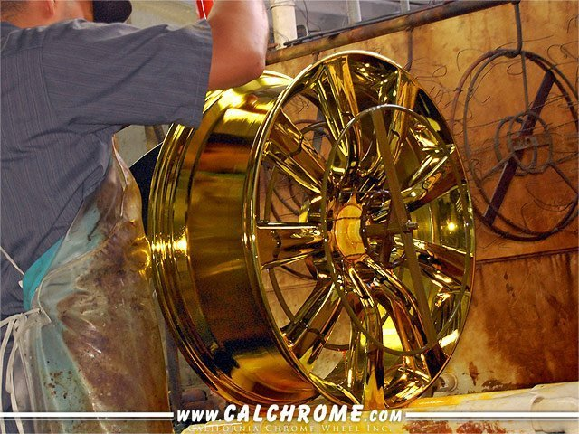 CHROME PLATING SOLUTION Alloy wheel shown after being dipped in chrome solution.