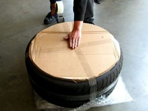 7. One cardboard round on back side of wheel.