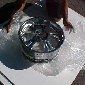 1. Securely wrap the wheel with a continuous sheet of bubble wrap.