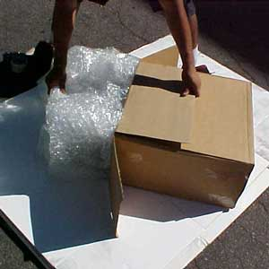 3. Carefully slide the wrapped wheel into the box