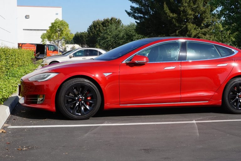 red tesla model s black wheels
