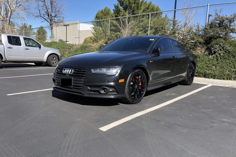 audi black wheels red calipers