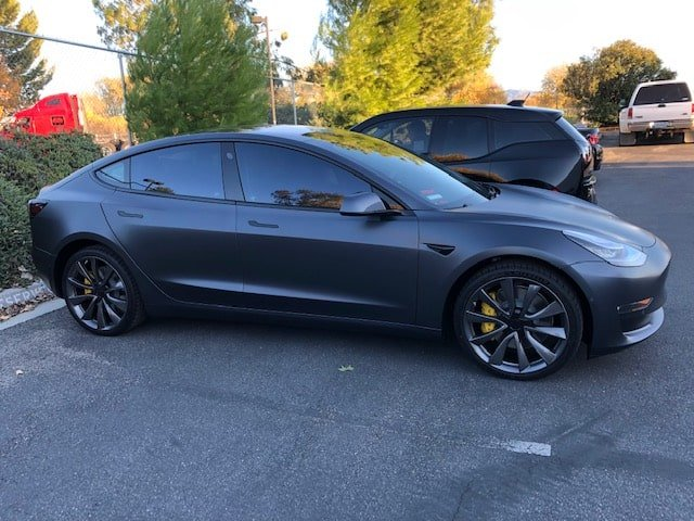 tesla grey wheels yellow calipers calchrome