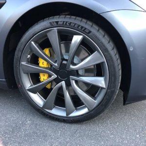tesla grey wheels yellow calipers
