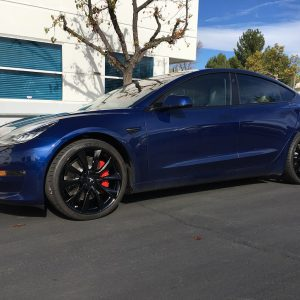 chrome delete for blue tesla model 3 with black wheels or rims with red brake calipers