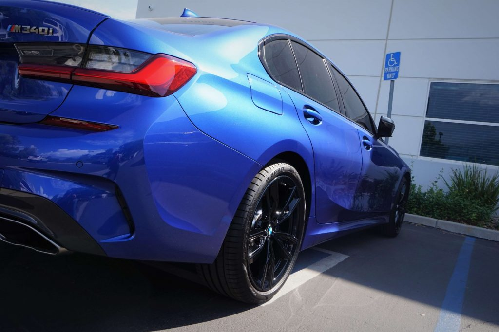 blue bmw m340i with oem gloss black wheels fusion powder coat by calchrome