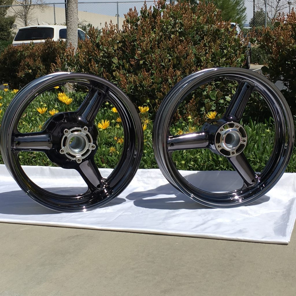 two motorcycle wheels in black chrome by calchrome